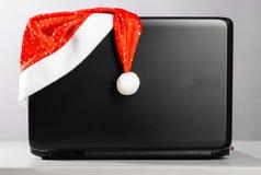 kapeluszowy laptop Santa Zdjęcia Stock