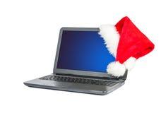 kapeluszowy laptop Santa Obraz Stock
