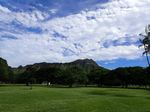 Kapiolani Park at during day with Diamond Head and clouds Royalty Free Stock Photography