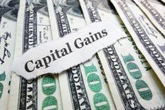 Kapitalvinstpengar arkivfoto