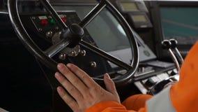 Kapitein bij het roer van boot stock footage