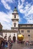 Kapitelplatz, Salzburg, golden sphere with man standing on top Royalty Free Stock Image