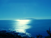Kapiti Island. A view of Kapiti Island, Wellington, New Zealand when the sun is setting royalty free stock photography