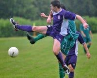 Kaposvar - Bekescsaba U19 soccer game. KAPOSVAR, HUNGARY - MAY 15: Mate Ferenczi (in purple) in action at the Hungarian National Championship under 19 game stock image