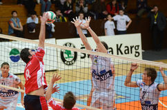 Kaposvar - Csepel volleyball game. KAPOSVAR, HUNGARY - MARCH 18: Alpar Szabo (2nd from R) blocks the ball at a Hungarian National Championship volleyball game stock photos