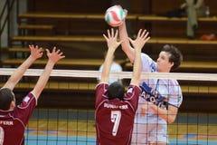 Kaposvar - Dunaferr volleyball game. KAPOSVAR, HUNGARY - JANUARY 17: Alpar Szabo (R) strikes the ball at a Hungarian volleyball National Championship game ( stock photo