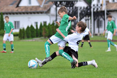Kaposvar - Paks U13 soccer game. KAPOSVAR, HUNGARY - MAY 29: Armin Prukner (in white) in action at the Hungarian National Championship under 13 game between Royalty Free Stock Photos