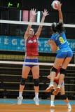Kaposvar - Szolnok volleyball game. KAPOSVAR, HUNGARY - OCTOBER 3: Barbara Balajcza (R) strikes the ball at the Hungarian NB I. League woman volleyball game Royalty Free Stock Images