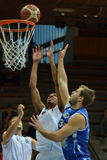 Kaposvar - Zalaegerszeg basketball game. KAPOSVAR, HUNGARY - SEPTEMBER 20: Unidentified players in action at a friendly basketball game with Kaposvar (blue) vs Royalty Free Stock Photo