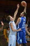 Kaposvar - Zalaegerszeg basketball game. KAPOSVAR, HUNGARY - SEPTEMBER 20: Roland Hendlein (in blue) in action at a friendly basketball game with Kaposvar (blue Stock Photography