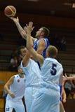 Kaposvar - Zalaegerszeg basketball game. KAPOSVAR, HUNGARY - SEPTEMBER 20: Roland Hendlein (in blue) in action at a friendly basketball game with Kaposvar (blue Stock Photos