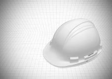 Kappe von Ingenieurfarbweiß auf Plan lizenzfreie stockbilder