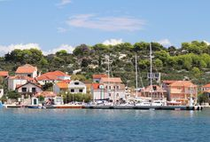 Kaprije, Croatia, Europe - 7 9 2018: Embankment of a small Croatian town in the Adriatic Sea. Sailing yacht on the background of t royalty free stock photography