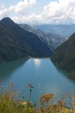 Kaprun lower reservoir sea. With cloudy blue sky Royalty Free Stock Photos