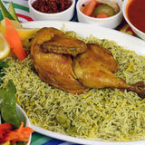 Kapsa chicken Rice Recipe. Beef Chicken - mixed rice dishes that originates in Yemen. Middle  eastern food Royalty Free Stock Photo