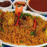 Kapsa Chicken Rice Recipe. Chicken Kabsa - mixed rice dishes that originates in Yemen. Middle  eastern food Stock Photo