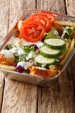 Kapsalon�is a Dutch food item consisting of fries, topped with d. Oner or shawarma meat and grilled with a layer of Gouda cheese and fresh vegetables royalty free stock image