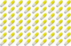 Kapslar som är ordnade i raden - preventivpillermodell Royaltyfria Bilder