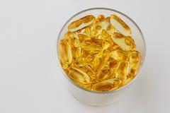 kapsuły łowią zdrowie szklanego olej Zdjęcie Stock