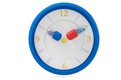 Kapsuła i zegar Zdjęcie Stock