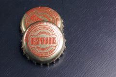 Kapsyler av desperadoöl Royaltyfri Bild