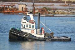 Kapten och Tug Boat Arkivfoto