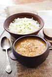 Kapustnyak - traditional Ukrainian winter soup with sauerkraut and millet. Obligatory dish on the Christmas Eve table stock photography