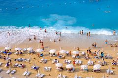 KAPUTAS BEACH, QAS, TURKEY, MAY 14, 2019: People enjoy relaxation, swimming and sunbathing on the famous Kaputas beach.  stock photo