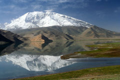 Kara Kul Lake. Mountain reflection in the Kara Kul lake in Karakorum China royalty free stock images