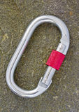 Karabiner on rock Royalty Free Stock Images