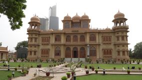 Karachi Mohatta Palace. Museum Frontal View at Hatim Alvi Road with Garden on a Cloudy Day stock video footage