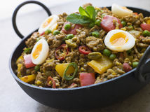 Karahi Dish with Punjabi Keema Mattar, Quail Eggs. Close up of Karahi Dish with Punjabi Keema Mattar and Quail Eggs royalty free stock photo
