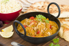 Karahi Gosht. Mutton curry cooked with tomatoes and topped with fried onions Royalty Free Stock Image