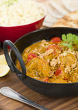 Karahi Gosht. Mutton curry cooked with tomatoes and topped with fried onions Stock Images