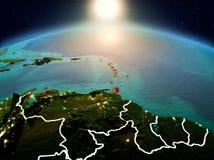 Karaiby w wschodzie słońca od orbity Obrazy Royalty Free