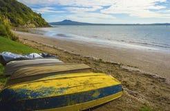 Karaka Bay Beach Auckland New Zealand. Dinghys at Karaka Bay Beach Auckland, New Zealand Royalty Free Stock Image
