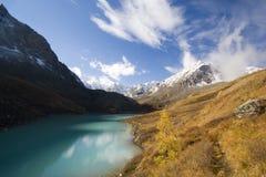 Karakabak lake and mountains. Scenic view of Karakabak lake with snow capped mountains in background, Altai, Russian Federation Stock Photo