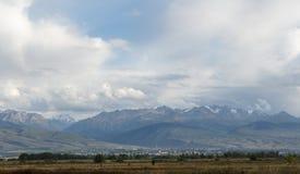 Karakol on the background of mountains. Issyk Kul, Kyrgyzstan Royalty Free Stock Photography
