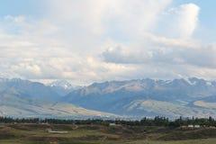 Karakol on the background of mountains. Issyk Kul, Kyrgyzstan Royalty Free Stock Photos