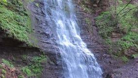 Karakol Glen Defile. Hidden rocky mountain waterfall in picturesque forest stock footage