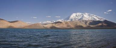 Karakol lake and in the background muztagh ata Stock Photos