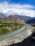 Karakoram Highway Mountain Range and Hunza River in Summer. View of the Karakoram Mountain Range and the Hunza River along the Highway in Summer Royalty Free Stock Photography