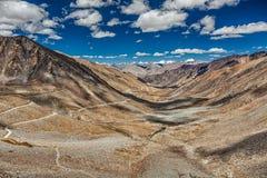 Karakoram Range and road in valley, Ladakh, India Royalty Free Stock Image