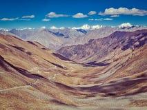 Karakoram Range and road in valley, Ladakh, India Stock Photo