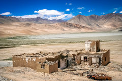 Karakorum Highway destroyed homes. Damaged and destroyed homes on the roadside of the Karakorum Highway, Xinjang province, China Royalty Free Stock Image
