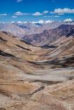 Karakorum Range and road in valley, Ladakh, India Stock Images