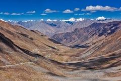 Karakorum Range and road in valley, Ladakh, India Royalty Free Stock Images
