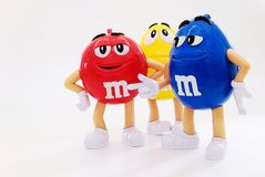 Karaktermascotte van chocolademerk m&m stock fotografie