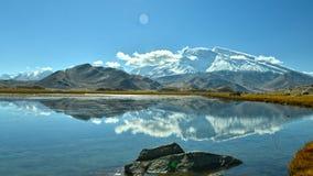 Karakul lake and Muztagh Ata Stock Photography