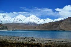 Karakul lake and pamir mountains in Xinjiang, Karakorum highway, China. Karakul lake and snowcovered mountains in Xinjiang, Karakorum highway, China royalty free stock photo